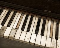 Looking down overhead view of old abandoned antique distressed piano keyboard close up. Antique piano originally made by Kohler and Campbell was abandoned and Stock Photos