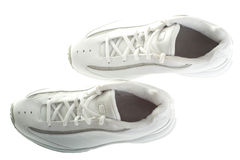 Looking down on a pair of basketball shoes. A pair of white basketball shoes isolated on a white background Royalty Free Stock Image