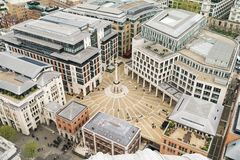 Looking down on Paternoster Square in London. Showing the Paternoster Square Column, offices, and tiny figures of people below Royalty Free Stock Photo