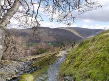 Looking down path and gate to Borrowdale, Lake District Royalty Free Stock Images