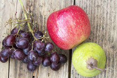 Looking down on a pear, apple and grapes Royalty Free Stock Photo