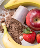 Looking down at place of meal replacement powder, apple, strawbe Royalty Free Stock Images