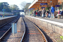 Looking down the railway tracks in a station. Royalty Free Stock Photography