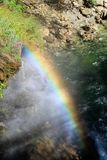 Looking down on rainbow in spray from waterfall Royalty Free Stock Photo