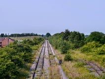Looking down redundant railway lines Stock Photo
