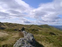 Looking down a ridge wall to Wansfell Pike, Lake District Royalty Free Stock Photo