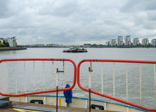 Looking down river from the back of the Woolwich ferry on the Th Royalty Free Stock Images
