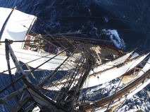 Looking down at sea from aloft in a tallship Stock Image