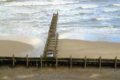 Looking down on the sea defence`s. Sea defence`s known as groyne`s which are sturdy wooden built structures to stop beach erosion on the north Norfolk coast at Royalty Free Stock Photos