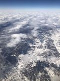 Looking down from the sky, the Earth covered with snow and white are stacked royalty free stock photo