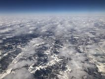 Looking down from the sky, the Earth covered with snow and white are stacked stock photography