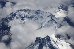 Looking down snowy mountains Stock Images