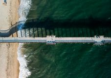 Looking down on a Southern California pier royalty free stock images