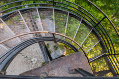 Looking Down on Spiral Metal Staircase. With bike rack below Stock Images