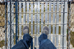 Looking down on a suspension bridge Stock Photos