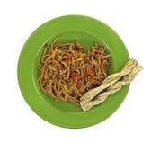 Teriyaki Noodles Cheese Twists. Looking down at teriyaki noodles and cheese twists Royalty Free Stock Photo