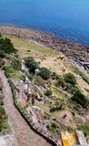 Terraced Gardens from St.Michaels Mount, Cornwall. Looking down at the terraced gardens at St.Michaels Mount with the rocky seashore at the bottom. The exposed royalty free stock photos