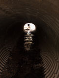 Looking Down a Texture Metal Tunnel in the Day Royalty Free Stock Images