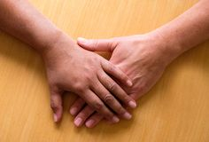 Looking down on two hands and lower arms placed ontop of each ot Royalty Free Stock Image
