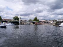 Looking down water to Wroxham Bridge, Norfolk Broads Stock Photography