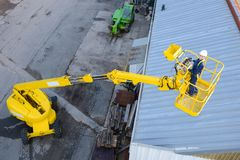 Looking down on woman in cherry picker. Cherry royalty free stock images