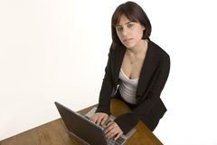 Looking down on a woman at her desk Stock Photo