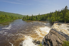 Looking downriver from a Wilderness Falls. Looking downriver from the Middle Falls of the Pigeon River in Ontario Royalty Free Stock Photo