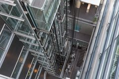 Looking downwards in a modern open elevator shaft Royalty Free Stock Image