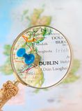 Looking in on Dublin, Ireland. Blue tack on map  with magnifying glass looking in on Dublin, Ireland, United Kingdom Stock Photos
