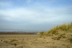 Sea view through the dunes. Looking through the dunes onto Holme next the sea beach on a bright sunny day Stock Photo