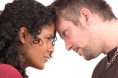 Looking each other in the eye. Lovely diverse couple with heads close together royalty free stock photo