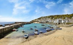 Looking east across Mousehole Harbour in Cornwall. On sunny day. UK Stock Photography