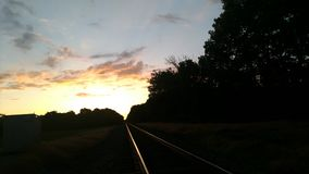 Looking east down railroad tracks at beautiful sunrise Royalty Free Stock Photography