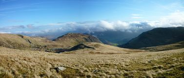 Looking east to clouds above Glenridding, panoramic Royalty Free Stock Photo