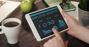 Looking at employee benefits records using digital tablet stock video