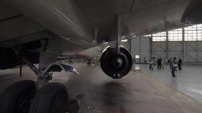 Airplane in repair hangar stock video