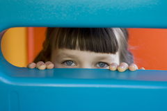 Looking eyes. Looking girl on a playground stock photos