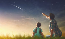 Looking at falling star. Father and his daughter are looking at falling star Royalty Free Stock Photography