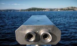 Looking far away with binocular Stock Photo