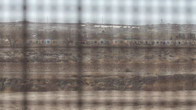 Looking Through the Fence on the US and Mexico Border 3. 4K pan shot with rack focus looking through the fence between the US and Mexico border stock video footage