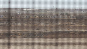 Looking Through the Fence on the US and Mexico Border 2. 4K rack focus pan shot looking through the fence on the US and Mexico border to the other side in the stock footage