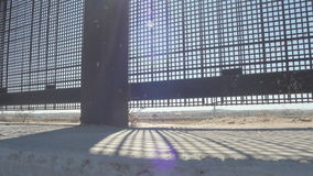Looking Through the Fence on the US and Mexico Border. Pan shot looking through the fence on the border of the US and Mexico border stock video footage
