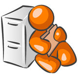 Looking at a file. An orange man leaning against a file cabinet looking at a file Stock Photography