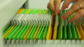 Looking files in desk drawer. Shot taken with a Canon 5D Mark2 - 1920x1080, 25fps stock footage