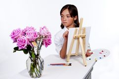 Looking at the flowers to paint. Stock Photo