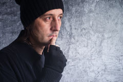 Looking into future. Looking into the future. Casual man with sad eyes making future plans Royalty Free Stock Photos