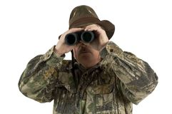 Looking for game. Using binoculars to look for game the hunter is checking out the area safely Royalty Free Stock Photography