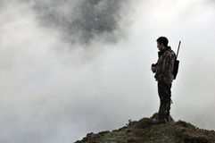 Looking for game. Hunter looking for game animals such as chamois, deer or tahr, in  South Westland's Southern Alps, New Zealand Royalty Free Stock Photos