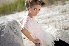 Looking girl. A serious girl with big hair looks in the frame Stock Photos