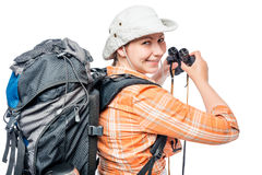Looking girl with a backpack and binoculars on a white Stock Images